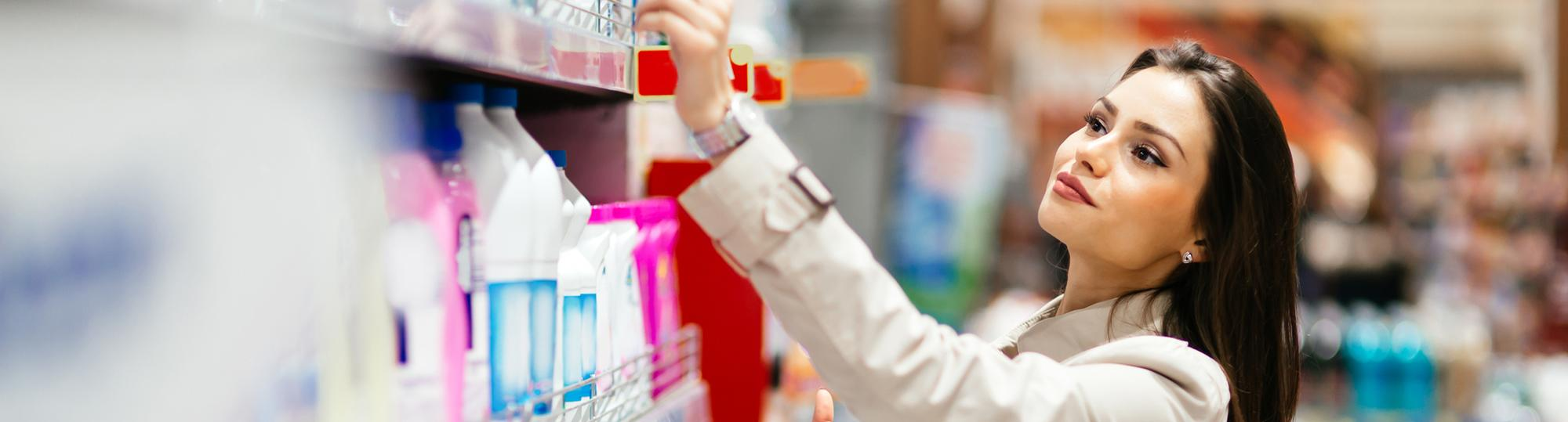 cvs deal hero woman shopping at pharmacy