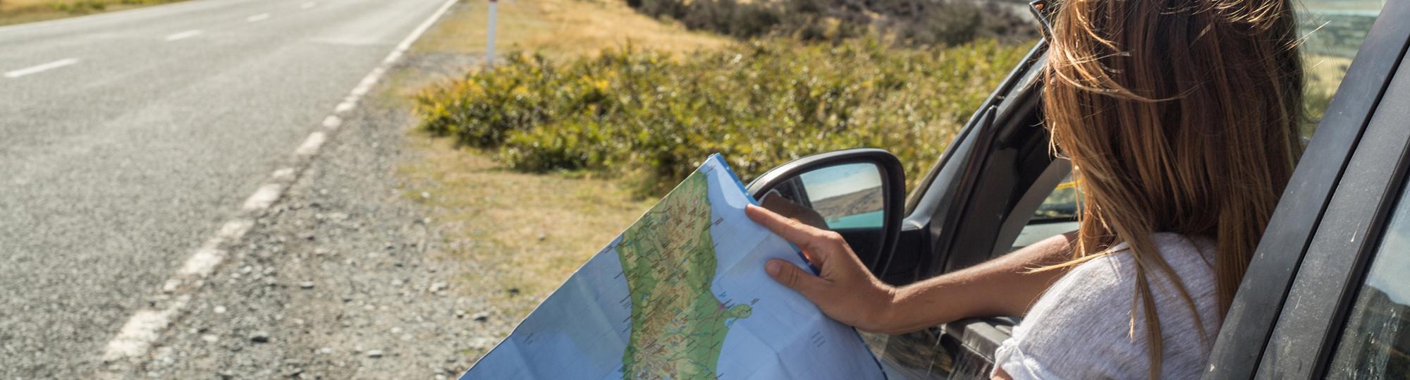 thrifty rental car deal hero girl on road trip in rental car