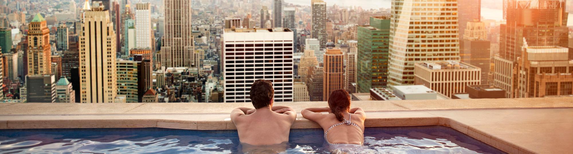 tryp deal hero couple in hotel pool