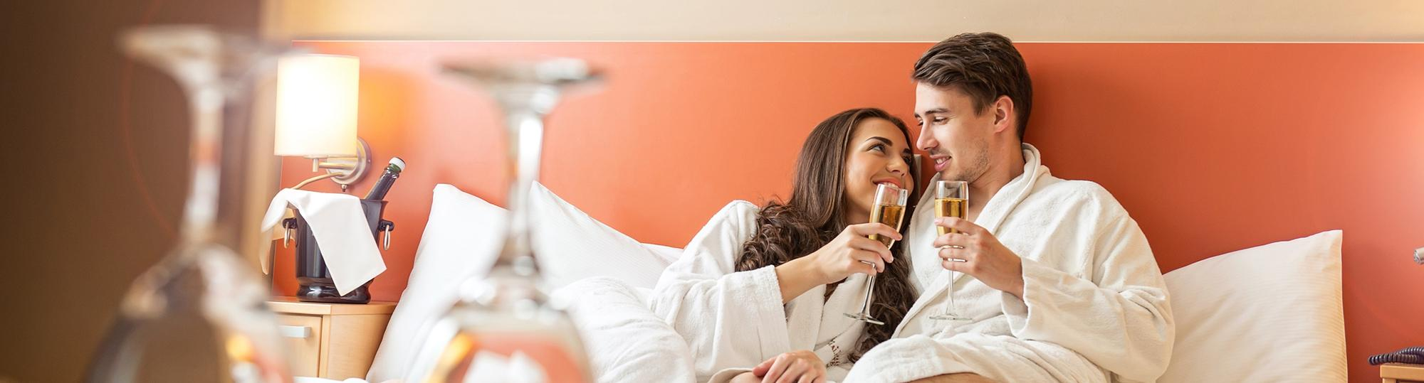 Wyndham hotels and resorts worldwide deal hero romantic couple on hotel bed