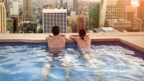 tryp deal tile couple in hotel pool