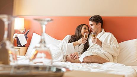 Wyndham hotels and resorts worldwide deal tile romantic couple on hotel bed